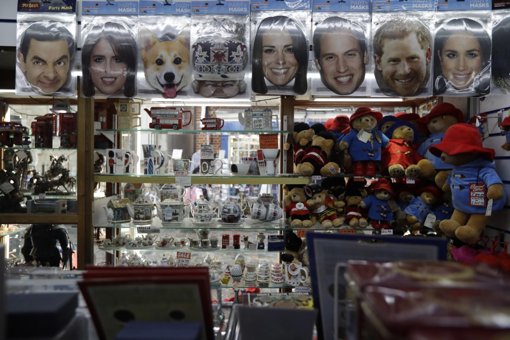 A Princess Eugenie mask, second left, is displayed for sale with other masks in a souvenir shop ahead of the wedding of Britain's Princess Eugenie in