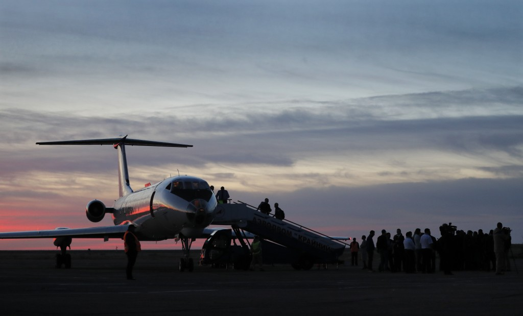 An aircraft carrying U.S. astronaut Nick Hague and Russian cosmonaut Alexey Ovchinin on board arrives at Baikonur airport, in Kazakhstan, Thursday, Oc