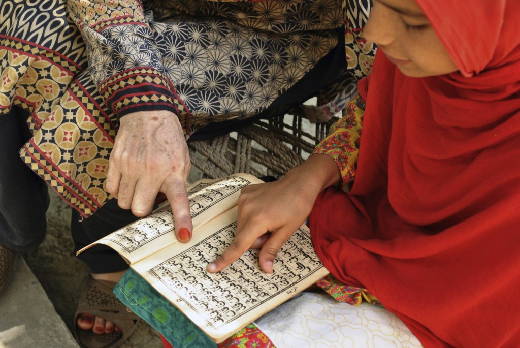 In this Tuesday, June 26, 2018, photo, Ansa Khan first's work in the morning after breakfast is to recite the Quran with her religious teacher in her
