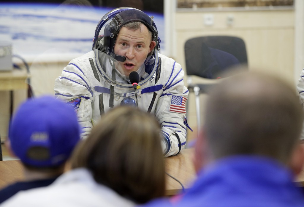 U.S. astronaut Nick Hague, a member of the main crew of the expedition to the International Space Station (ISS), speaks with his relatives through a s