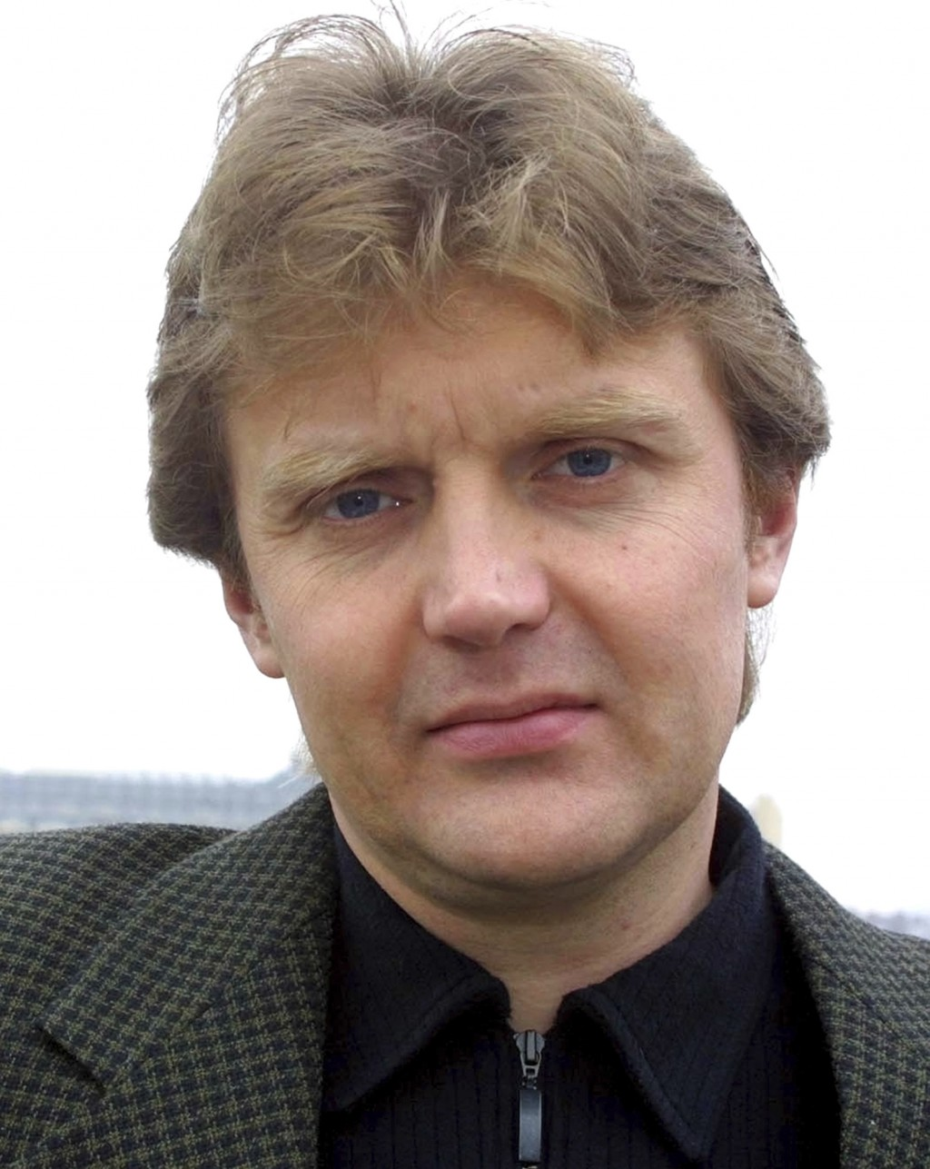 FILE - In this May 10, 2002 file photo, Alexander Litvinenko, former KGB spy is photographed at his home in London. Litvinenko, who defected to Britai