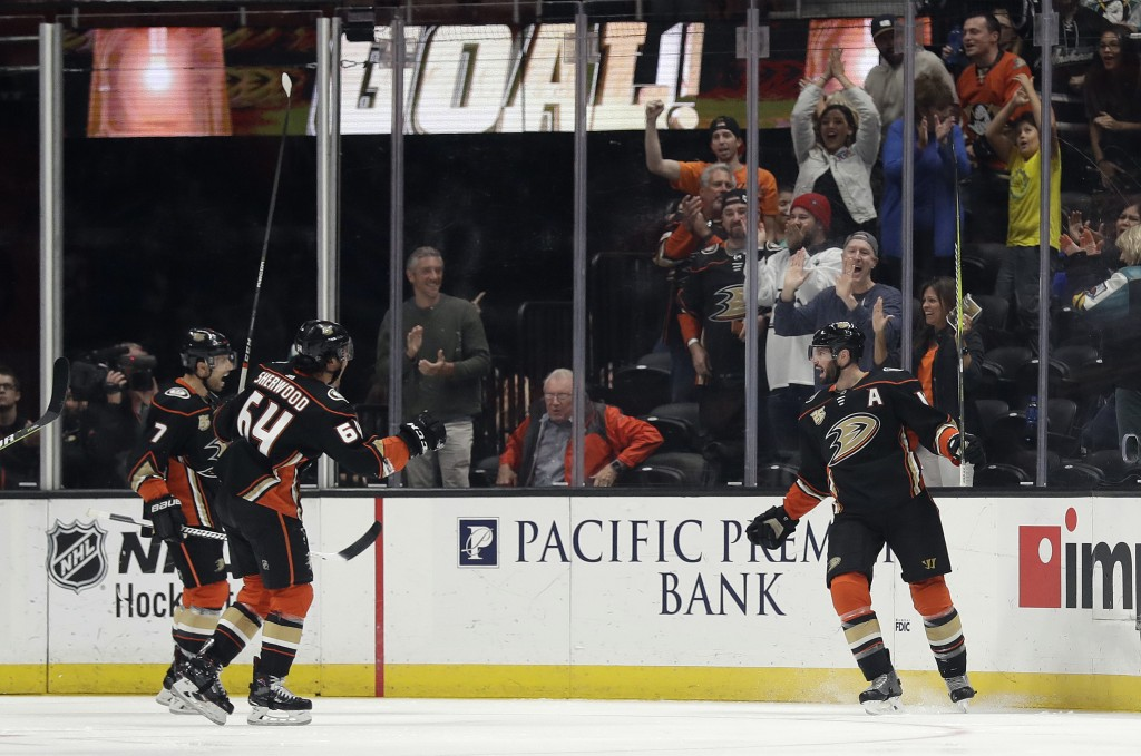 Anaheim Ducks' Ryan Kesler, right, celebrates after scoring against the Arizona Coyotes during the first period of an NHL hockey game Wednesday, Oct.