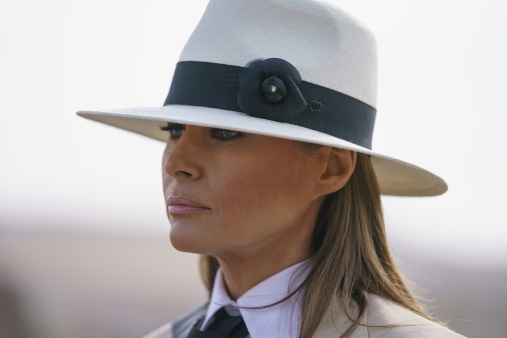 In this Oct. 6, 2018 photo, First lady Melania Trump pauses as she speaks to media during a visit to the historical Giza Pyramids site near Cairo, Egy