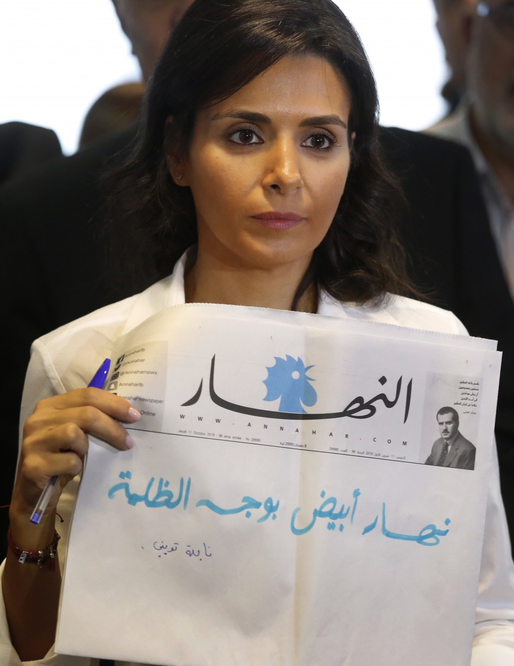 Nayla Tueni, the editor-in-chief of An-Nahar daily newspaper, holds a copy of a blank published newspaper in a strong protest against the paralysis in