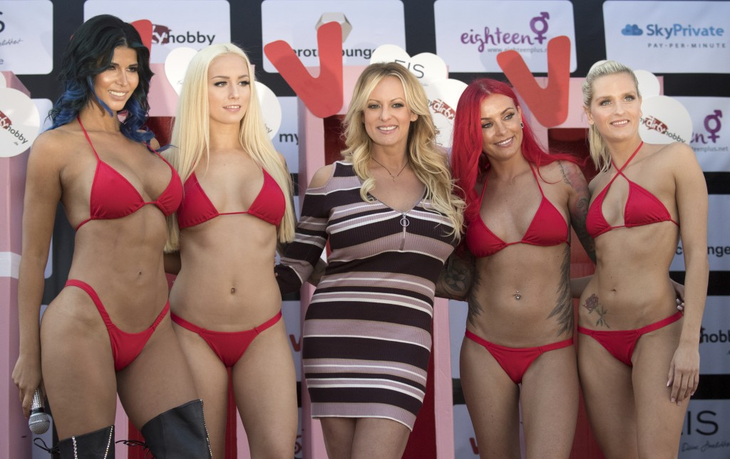 Adult film actress Stormy Daniels, 3rd left, attends the opening of the adult entertainment fair 'Venus' in Berlin, Germany, Thursday, Oct. 11, 2018.
