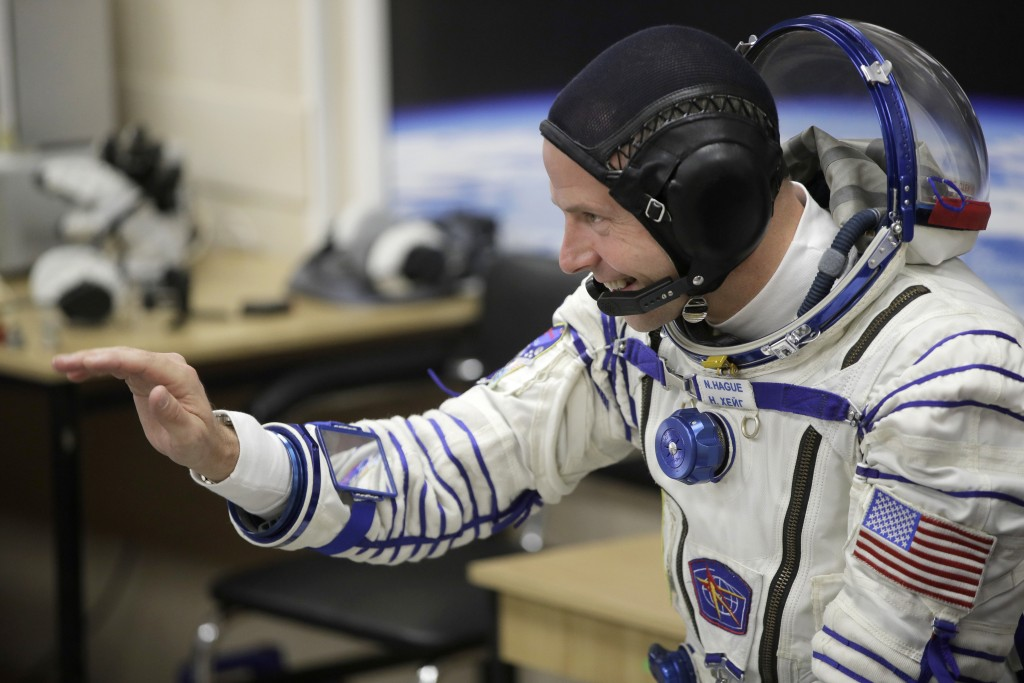 U.S. astronaut Nick Hague, a member of the main crew of the expedition to the International Space Station (ISS), gestures prior to the launch of Soyuz