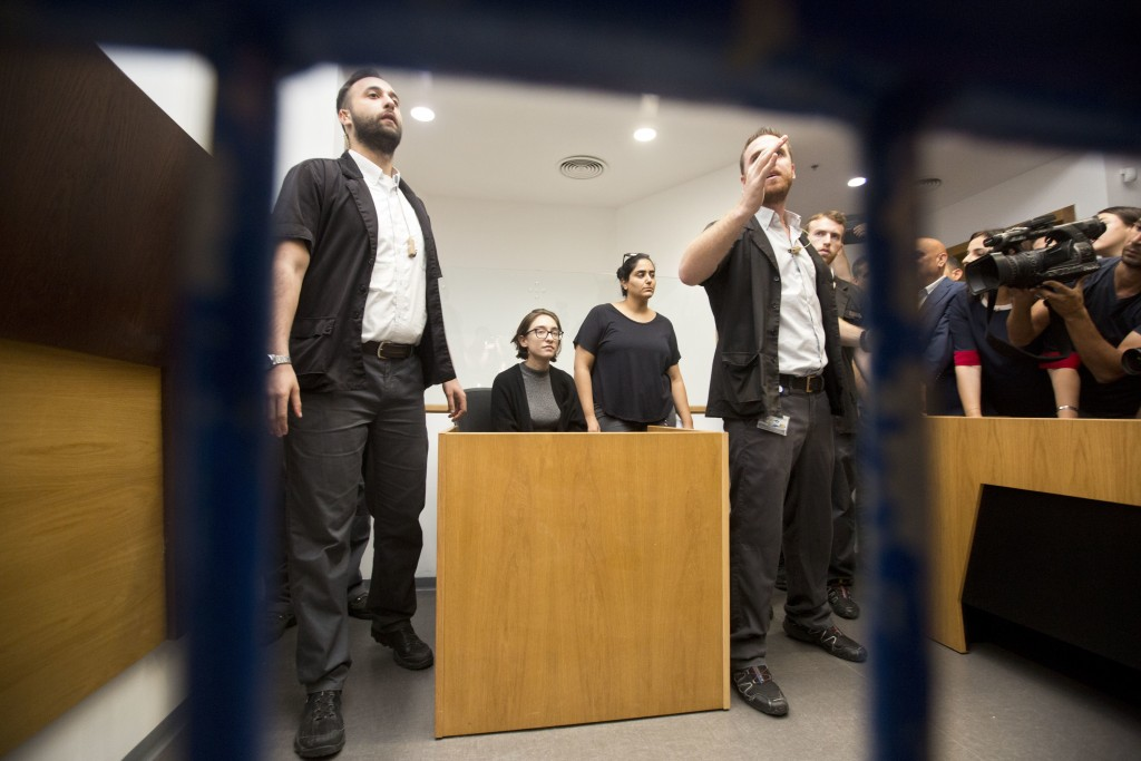 American Lara Alqasem, center, sits in a courtroom prior to a hearing at the district court in Tel Aviv, Israel, Thursday, Oct. 11, 2018. A senior Isr