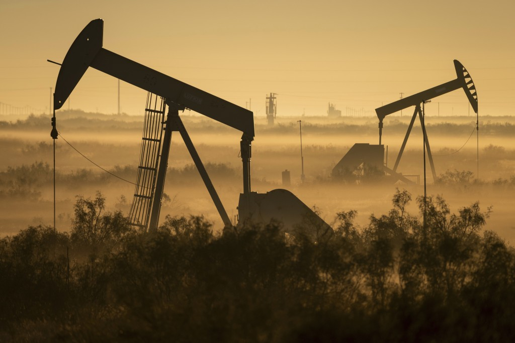 Fog blankets a low-lying area where pumpjacks operate in West Texas, northeast of Kermit, on Sept. 12, 2018. In December 2017, companies in the Permia