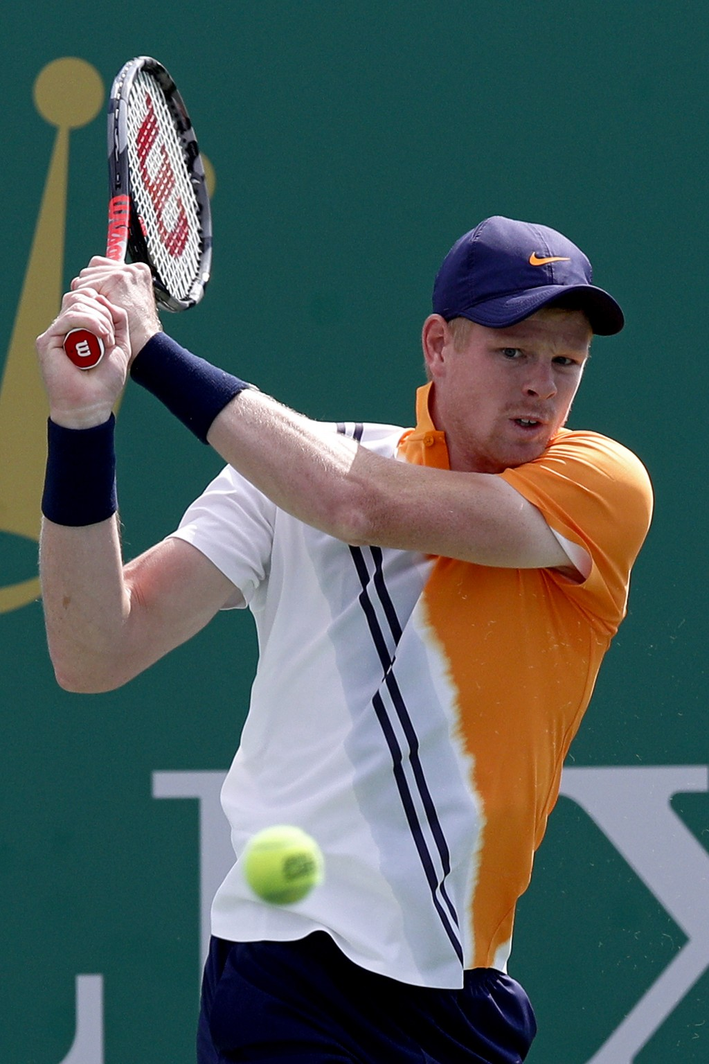 Kyle Edmund of Britain hits a return shot to Nicolas Jarry of Chile during their men's singles match of the Shanghai Masters tennis tournament at Qizh