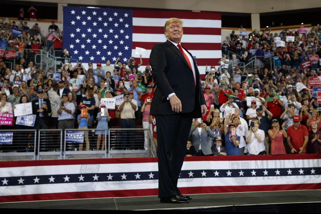President Donald Trump arrives to speak at a campaign rally at Erie Insurance Arena, Wednesday, Oct. 10, 2018, in Erie, Pa. (AP Photo/Evan Vucci)