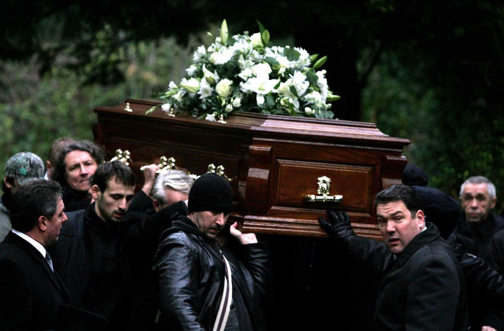 FILE - In this Dec. 7, 2006 file photo, the coffin of former Russian spy Alexander Litvinenko is carried during his funeral in north London. Litvinenk