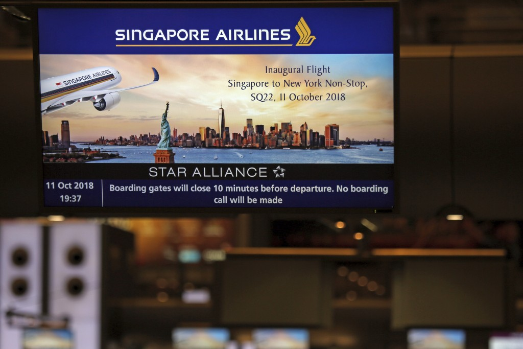 A screen advertising Singapore Airline's inaugural non-stop flight to New York is flashed on a screen at Changi International Airport on Thursday, Oct