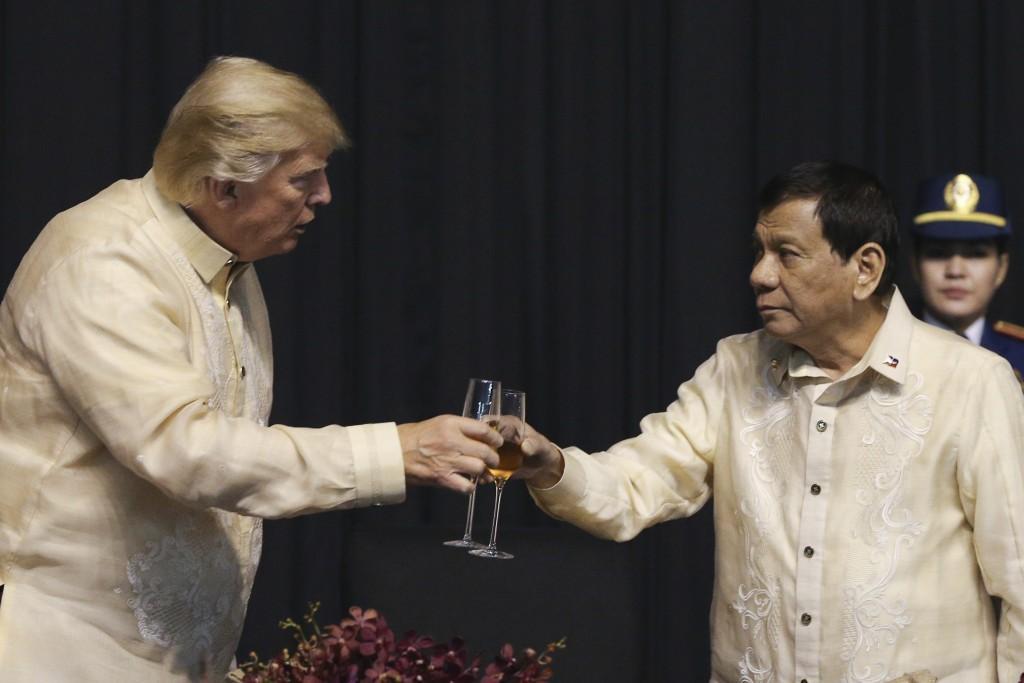 U.S. President Donald Trump toasts with Philippines President Rodrigo Duterte during the gala dinner marking ASEAN's 50th anniversary in Manila, Phili
