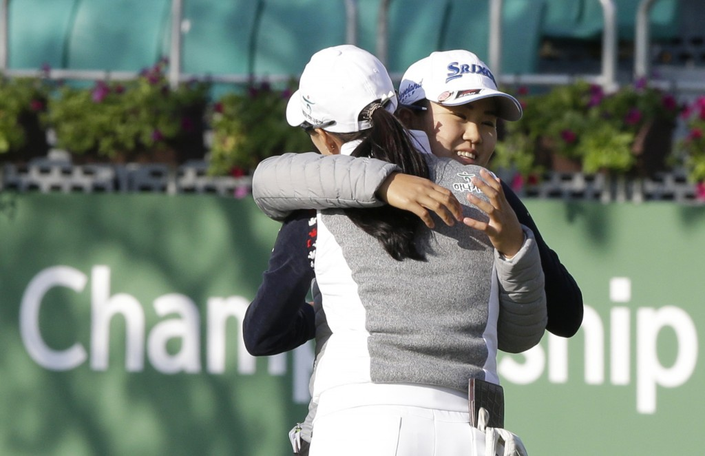 Nasa Hataoka, right, of Japan hugs Minjee Lee of Australia after finishing the first round of the LPGA KEB Hana Bank Championship at Sky72 Golf Club i