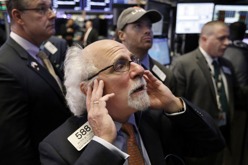 Trader Peter Tuchman works on the floor of the New York Stock Exchange, Thursday, Oct. 11, 2018. The market's recent decline was set off by a sharp dr