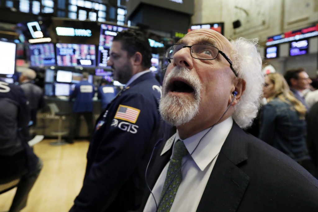 Trader Peter Tuchman works on the floor of the New York Stock Exchange, Wednesday, Oct. 10, 2018. The Dow Jones Industrial Average plunged more than 8...