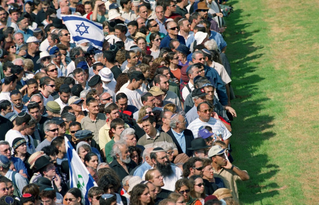 FILE - In this Oct. 18 2001 file photo, mourners wait to pass by the flag-draped coffin of assassinated Israeli Tourism Minister Rehavam Zeevi, who li