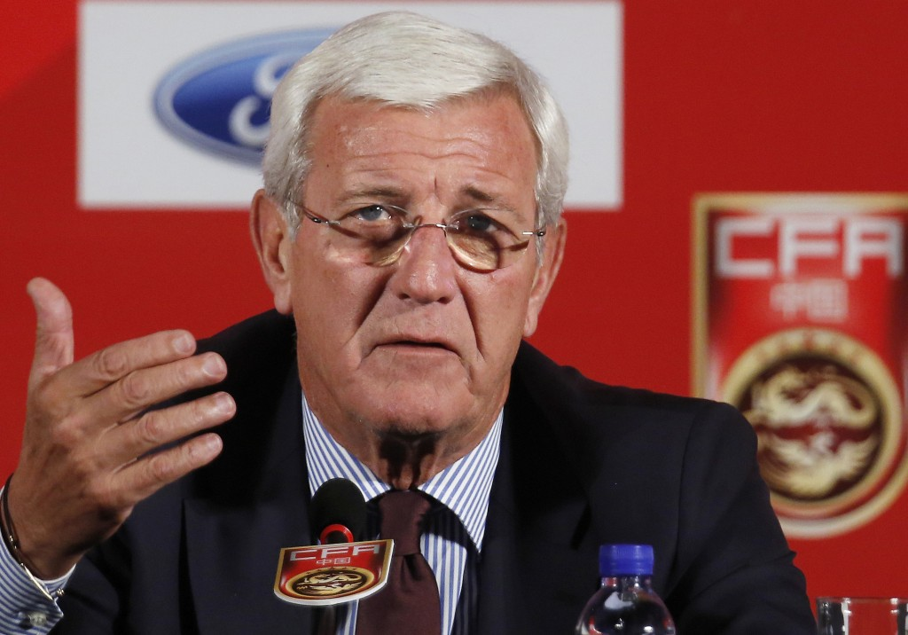 FILE - In this Oct. 28, 2016, file photo, China's national football team coach Marcello Lippi speaks during a news conference at a hotel in Beijing. S