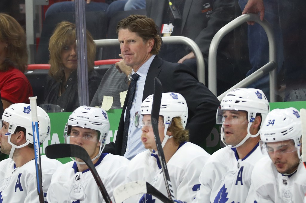 Toronto Maple Leafs coach Mike Babcock watches during the first period of the team's NHL hockey game against the Detroit Red Wings, Thursday, Oct. 11,