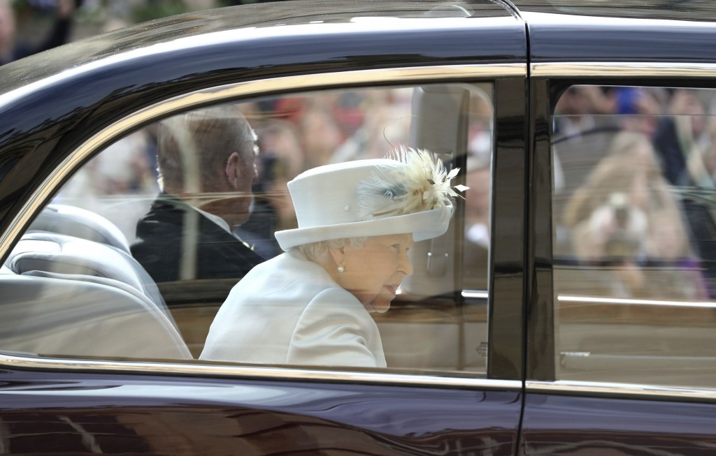 Britain's Queen Elizabeth and Prince Philip arrive ahead of the wedding of Princess Eugenie of York and Jack Brooksbank at St George's Chapel, Windsor