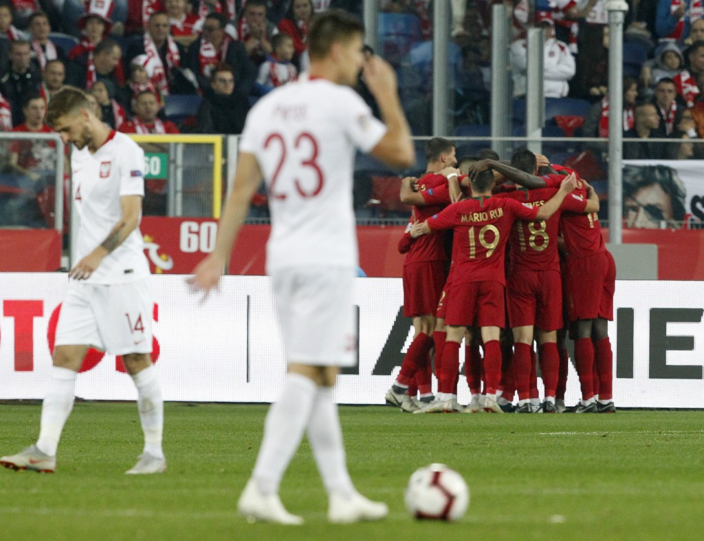 portuguese players celebrate scoring their side's third goal during the UEFA Nations League soccer match between Poland and Portugal at the Silesian S