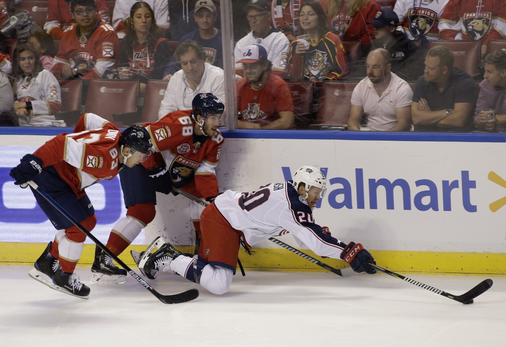 Florida Panthers right wing Evgenii Dadonov (63) and left wing Mike Hoffman (68) chase Columbus Blue Jackets center Riley Nash (20) during the first p