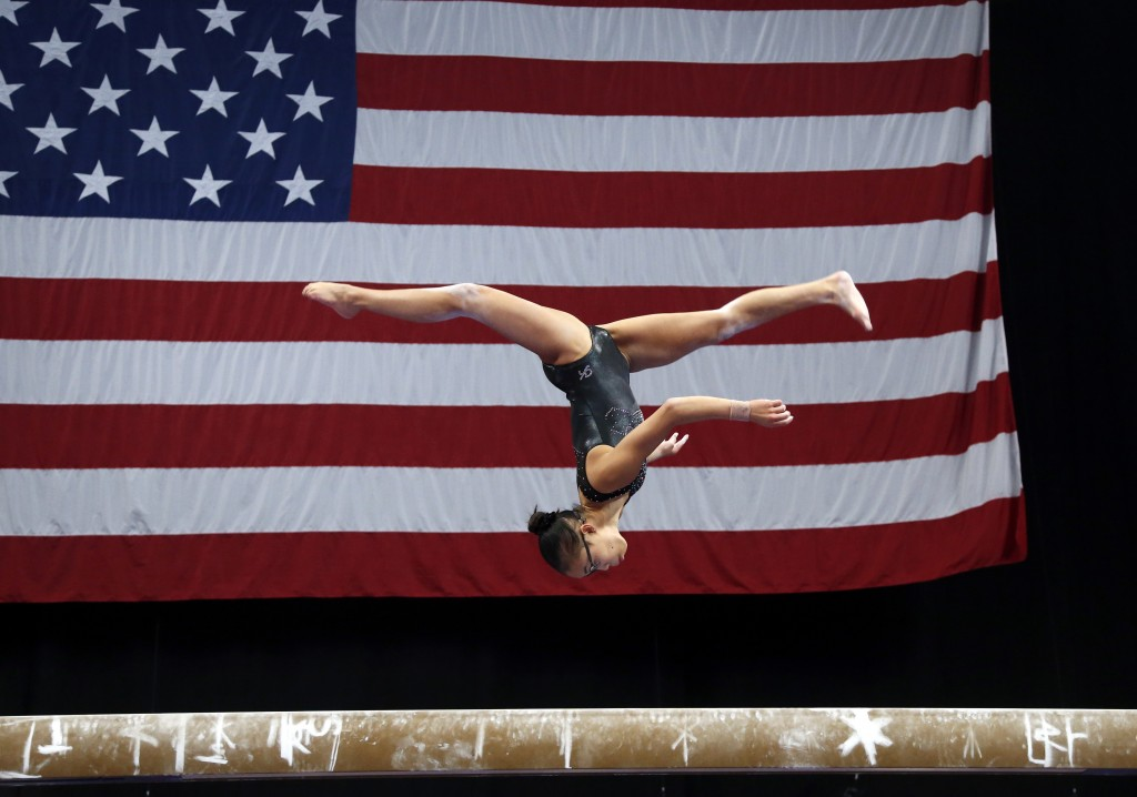 FILE - In this Aug. 15, 2018, file photo, Morgan Hurd practices on the balance beam during a training session at the U.S. Gymnastics Championship. (AP