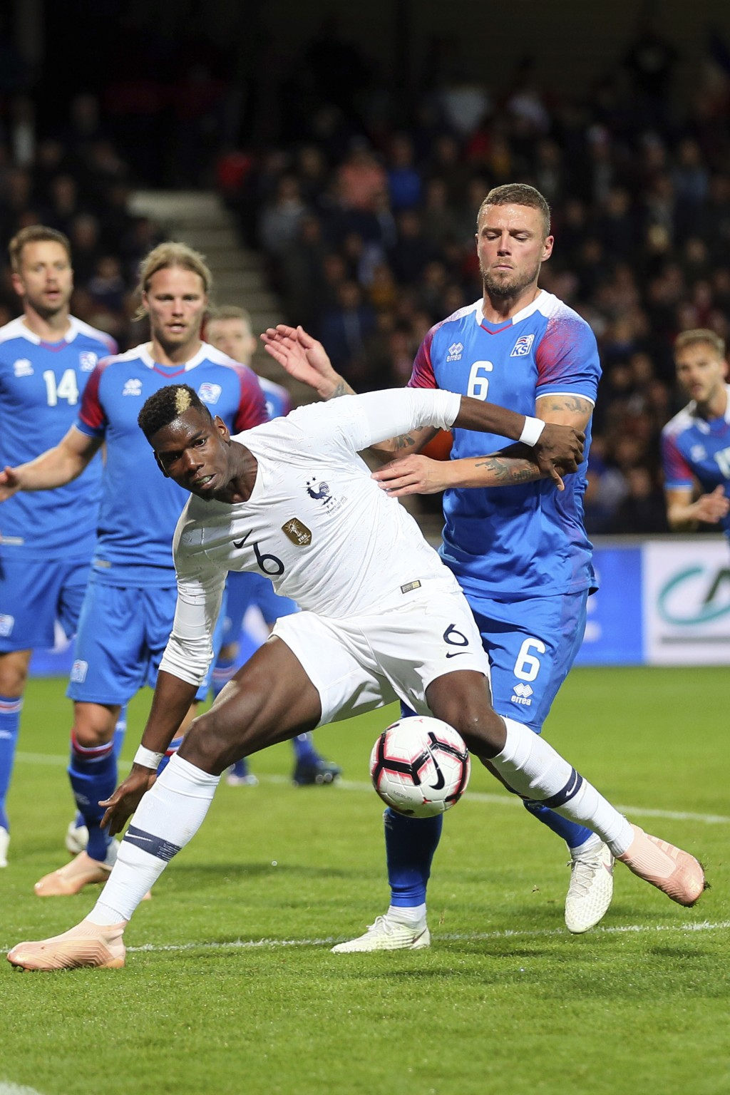 France's Paul Pogba, foreground, challenges for the ball with Iceland's Ragnar Sigurdsson, during a friendly soccer match between France and Iceland,