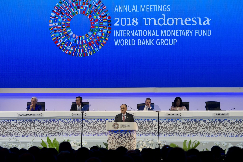 World Bank President Jim Yong Kim, foreground, delivers his speech during the opening of International Monetary Fund (IMF) World Bank annual meetings