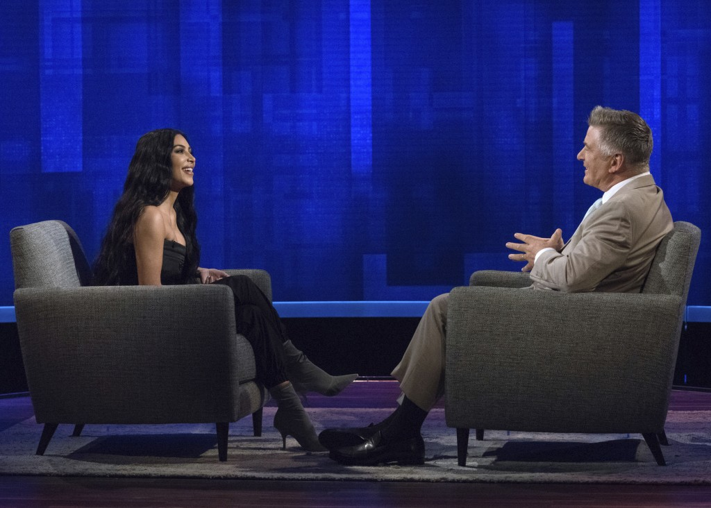 """This image released by ABC shows host Alec Baldwin, right, speaking with TV personality Kim Kardashian West during an appearance on """"The Alec Baldwin"""