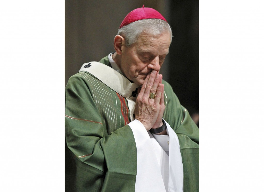 In this Wednesday, Oct. 20, 2010 file photo, Archbishop Donald Wuerl prays as he celebrates Mass at the Cathedral of Saint Matthew the Apostle in Wash