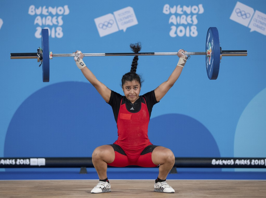 In this Tuesday, Oct. 9, 2018 photo, Peru's Gianella Valdiviezo snatches as she competes in the Women's Weightlifting 53kg category in the Asia Pavili