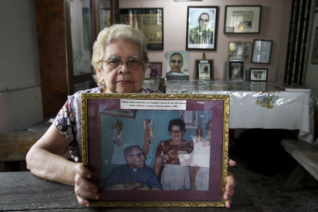 In this Oct. 4. 2018 photo, Leonor Chacon shows a March 1980 photograph of Archbishop Oscar Arnulfo Romero a few days before the was assassinated, at