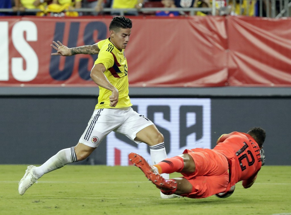 U.S. goalkeeper Zack Steffen (12) blocks a shot by Colombia's James Rodriguez, left, during the first half of an international friendly soccer match T