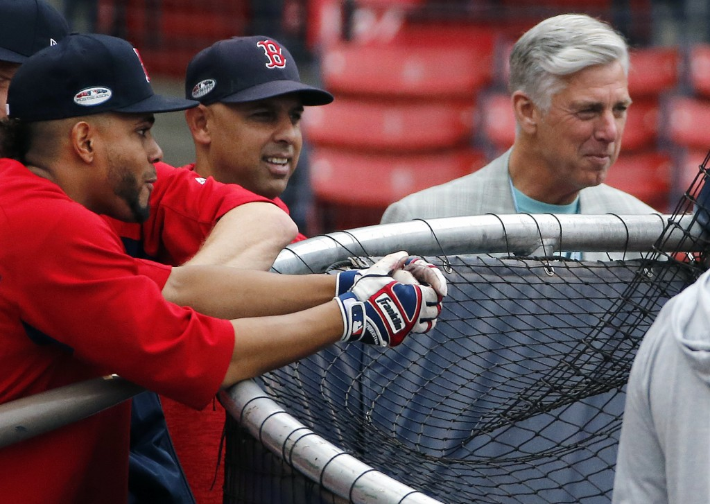 From left, Boston Red Sox shortstop Xander Bogaerts, manager Alex Cora and president of baseball operations Dave Dombrowski watch from behind the batt