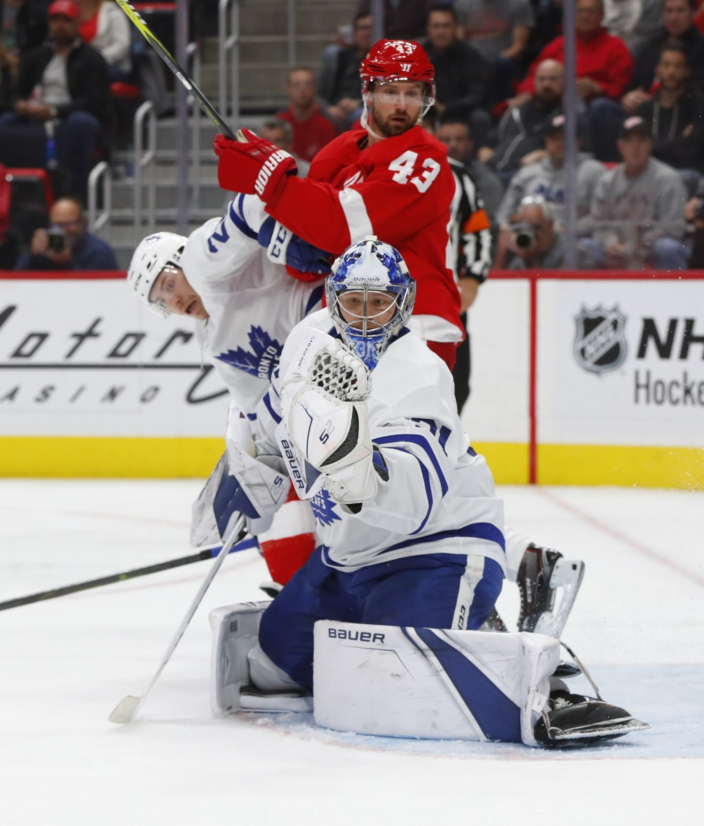 Toronto Maple Leafs goaltender Frederik Andersen (31) stops a Detroit Red Wings shot during the second period of an NHL hockey game Thursday, Oct. 11,