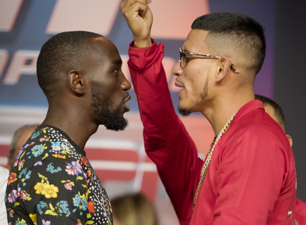 "Boxers Jose Benavidez Jr., right, of Phoenix,, and Terence ""Bud"" Crawford, of Omaha, face each other during a news conference in Omaha, Neb., Thursday"