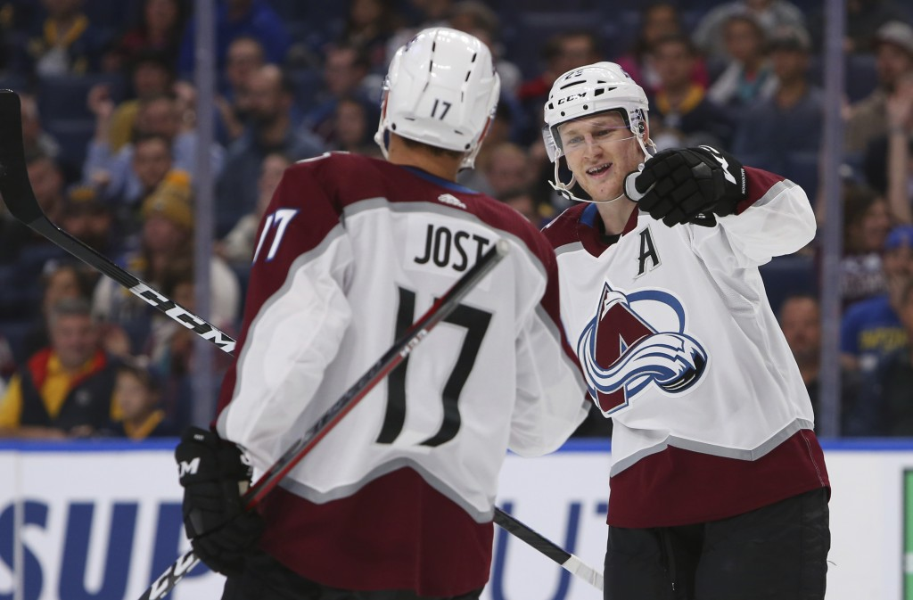 Colorado Avalanche forwards Tyson Jost (17) and Nathan MacKinnon (29) celebrate a goal during the first period of the team's NHL hockey game against t