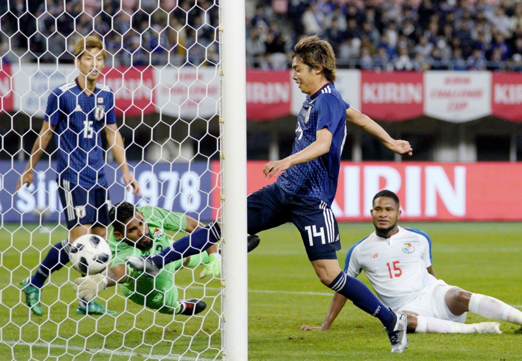 Japan's Junya Ito, second right, scores the team's second goal during the last half of their Kirin Challenge Cup soccer match against Panama in Niigat