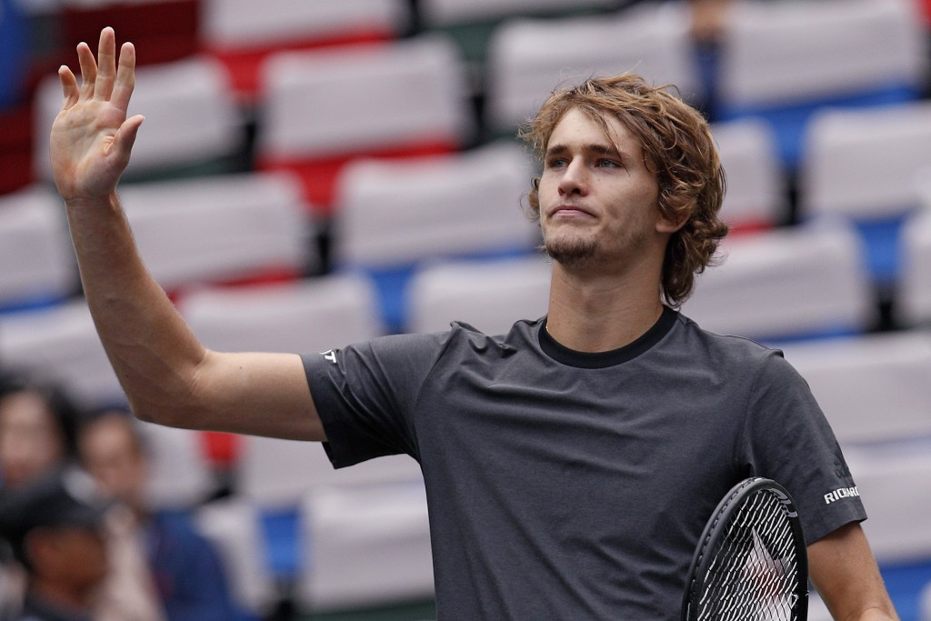 Alexander Zverev of Germany gestures to the spectators after winning his men's singles quarterfinals match against Kyle Edmund of Britain in the Shang