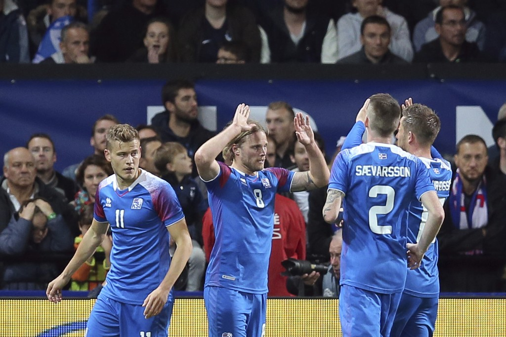 Iceland's Birkir Bjarnason, second from left, celebrates with teammate after scoring a goal during a friendly soccer match between France and Iceland,
