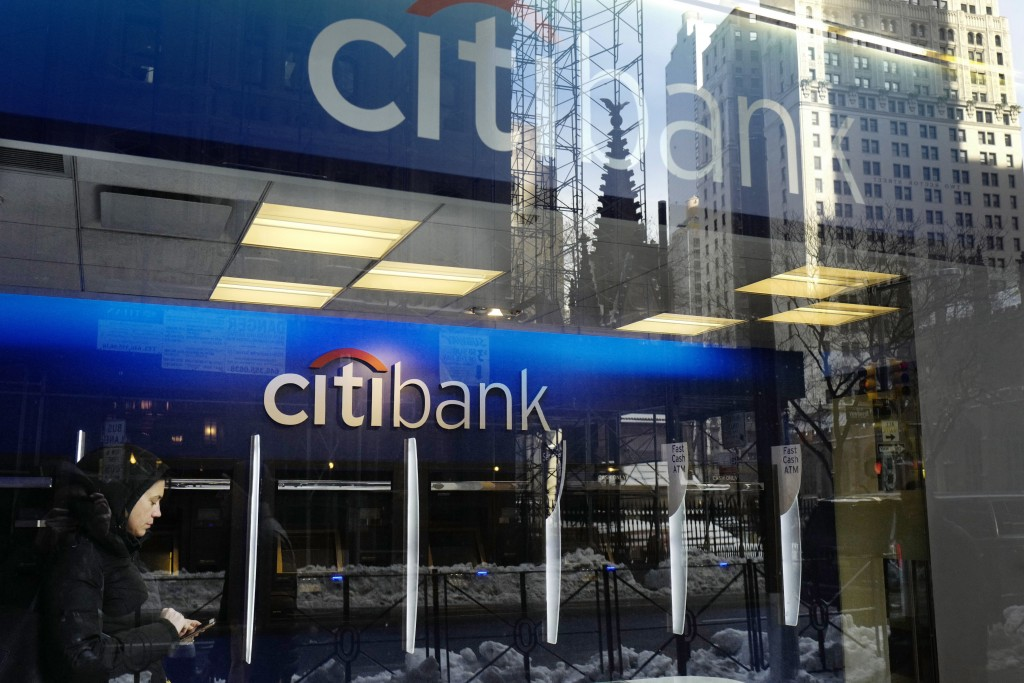 FILE - In this March 16, 2017, file photo, a customer enters a Citibank branch, in New York. Citigroup reports earnings Friday, Oct. 12, 2018. (AP Pho