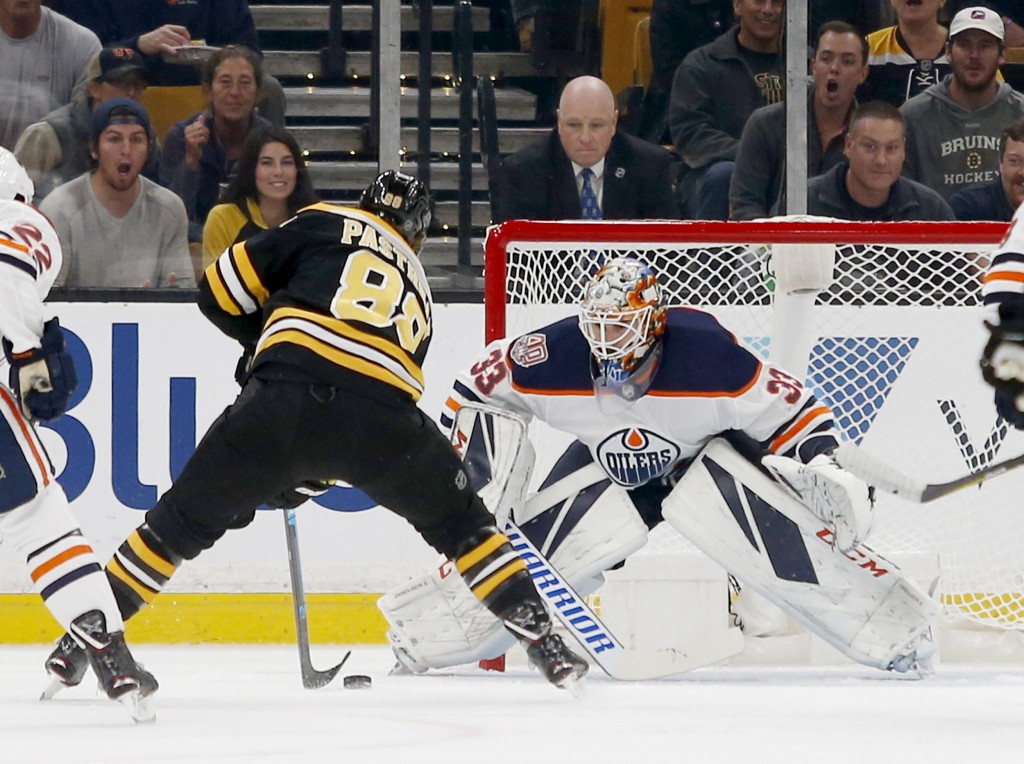 Boston Bruins right wing David Pastrnak (88) scores a goal against Edmonton Oilers goaltender Cam Talbot (33) during the first period of an NHL hockey
