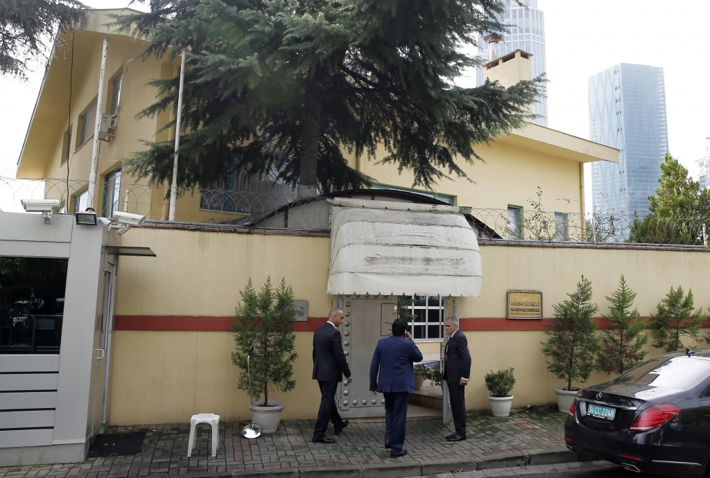 Saudi officials enter Saudi Arabia's consulate in Istanbul, Friday, Oct. 12, 2018. A senior Turkish official says Turkey and Saudi Arabia will form a
