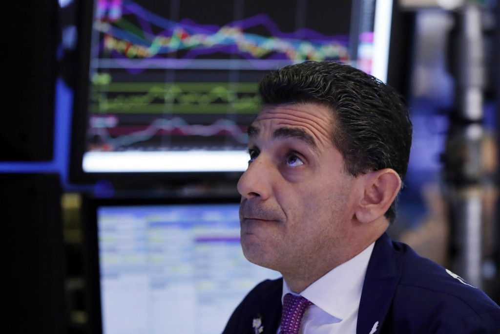 Specialist Peter Mazza works on the floor of the New York Stock Exchange, Thursday, Oct. 11, 2018. Stocks are slumping for a second straight day as th