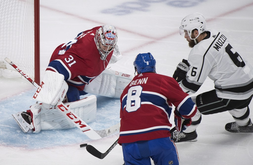 Montreal Canadiens goaltender Carey Price makes a save against Los Angeles Kings' Jake Muzzin (6) as Canadiens' Jordie Benn defends during the second