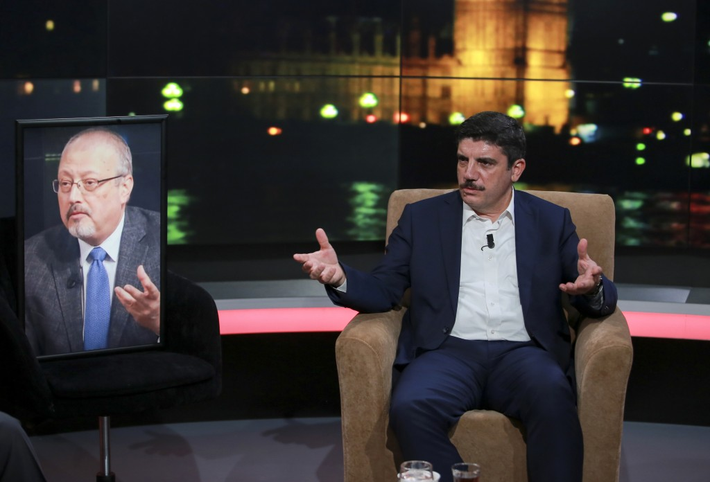Yasin Aktay, an advisor to Turkey's President Recep Tayyip Erdogan and a good friend sits next to an empty chair with a picture of Saudi writer Jamal