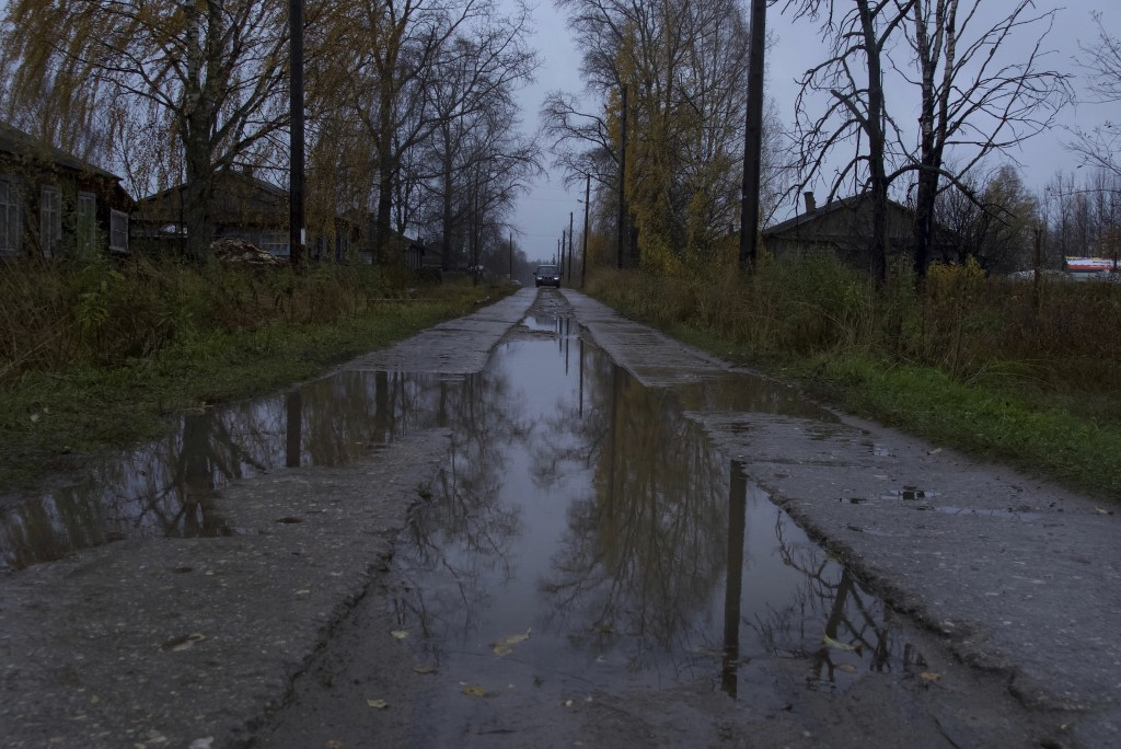 A car drives on a street in the village of Loyga, northern Russia, Wednesday Oct. 10, 2018. The career trajectories of suspected Russian military inte