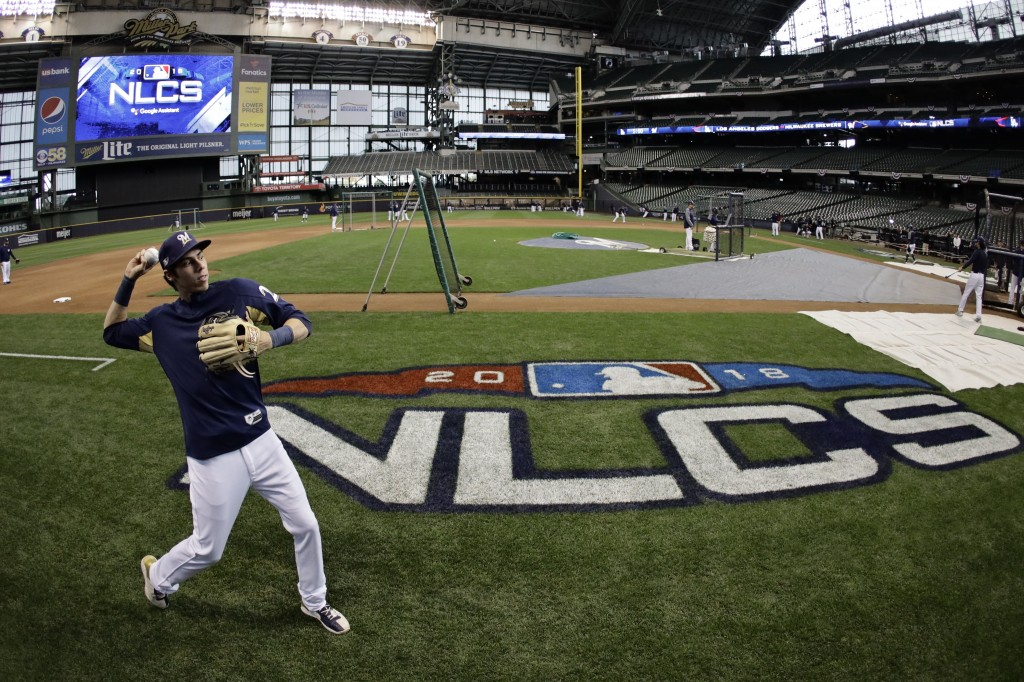 Milwaukee Brewers' Christian Yelich warms up for practice for Game 1 of the National League Championship Series baseball game Los Angeles Dodgers Thur
