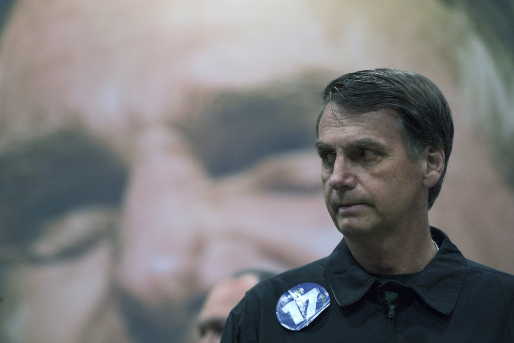 Presidential candidate Jair Bolsonaro, of the right wing Social Liberal Party arrives for a press conference in Rio de Janeiro, Brazil, Thursday, Oct.